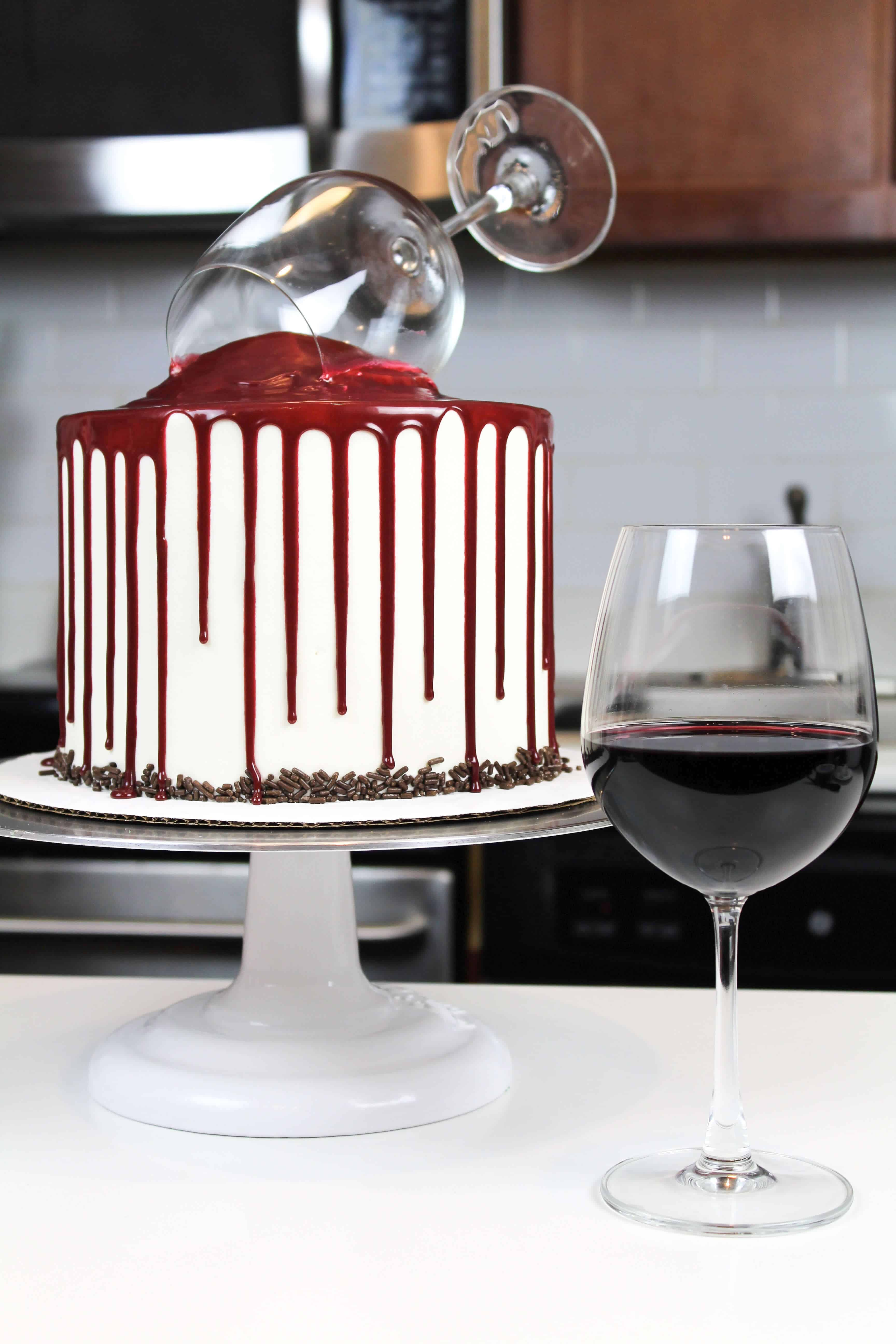 Image of a red wine chocolate cake next to a glass of red wine
