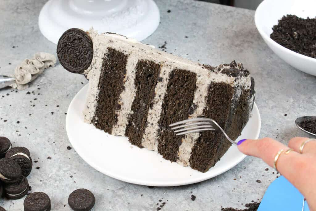 photo of chocolate oreo cake slice with oreo frosting