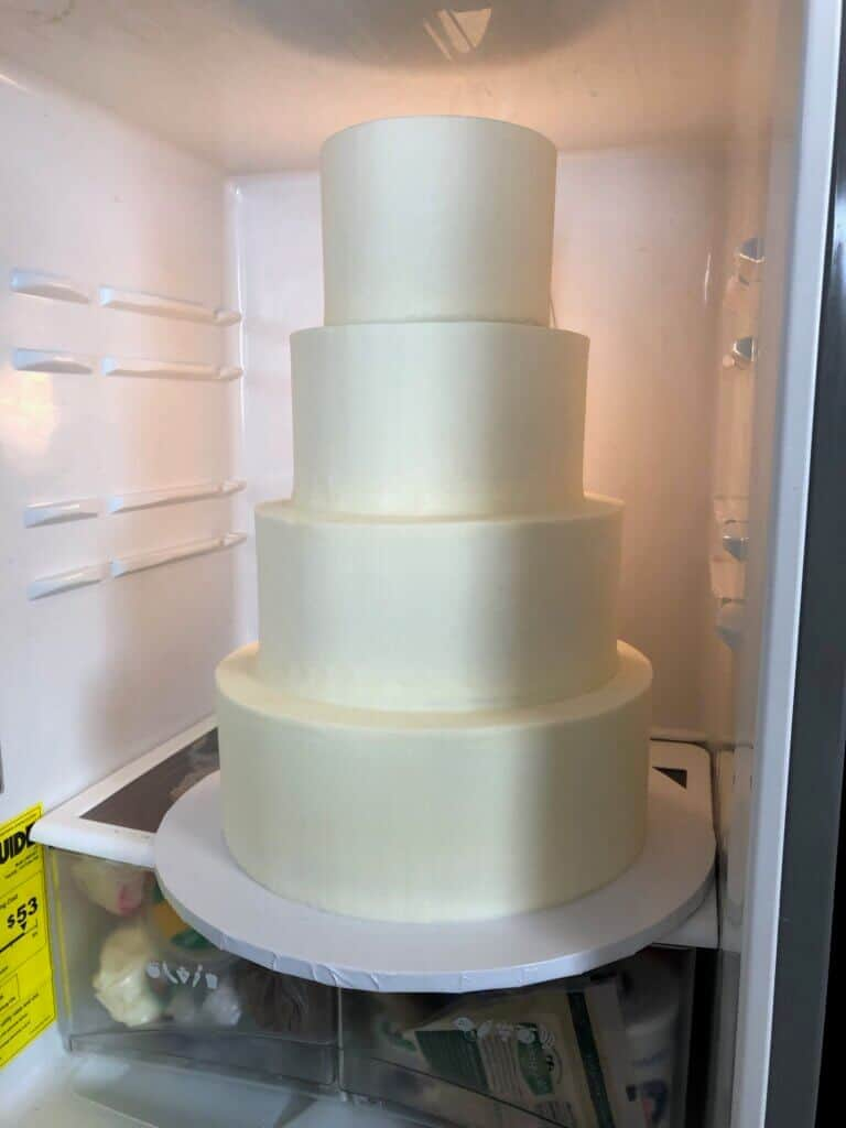 photo of wedding cake in normal fridge with 16 inch base