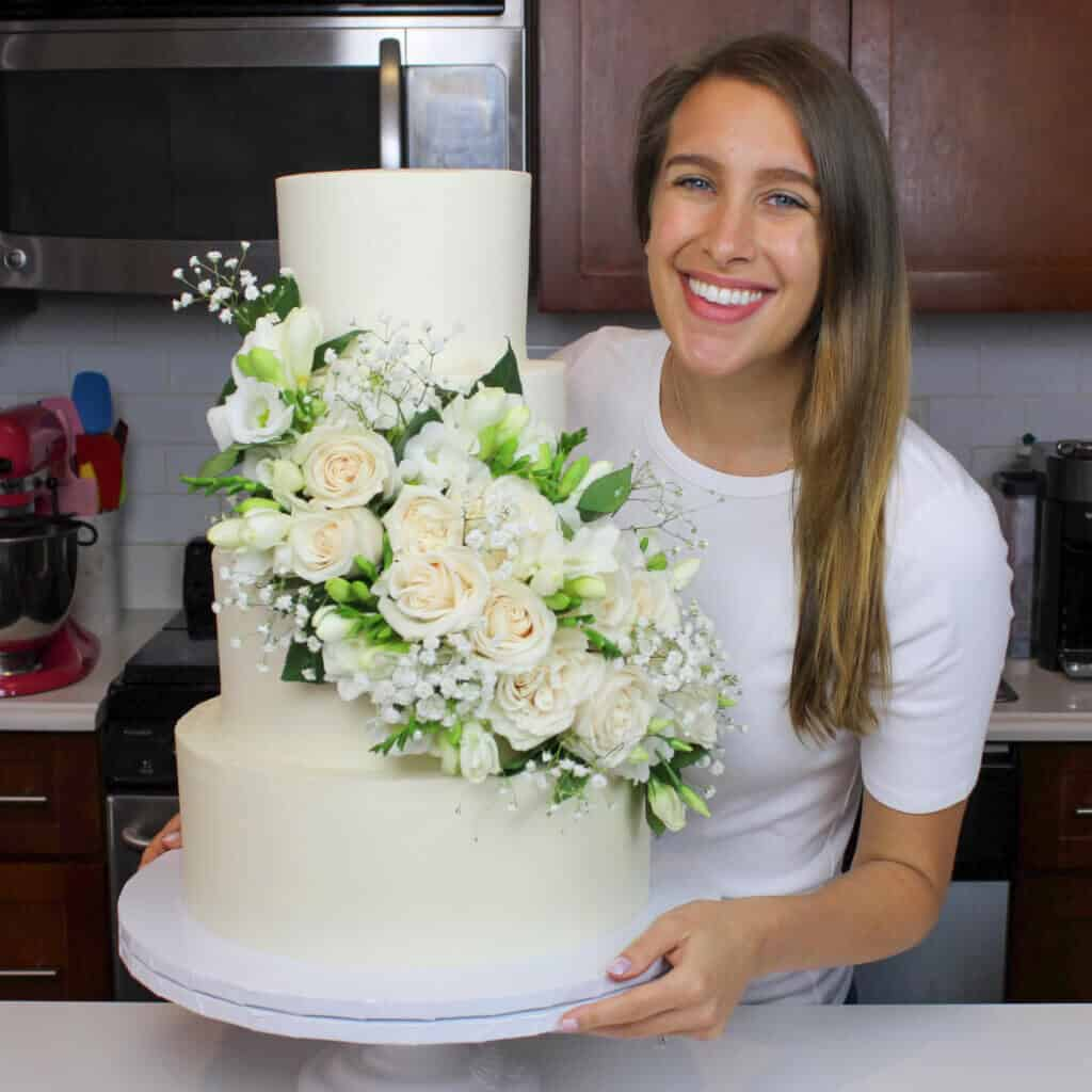 photo of chelsey white with her wedding cake