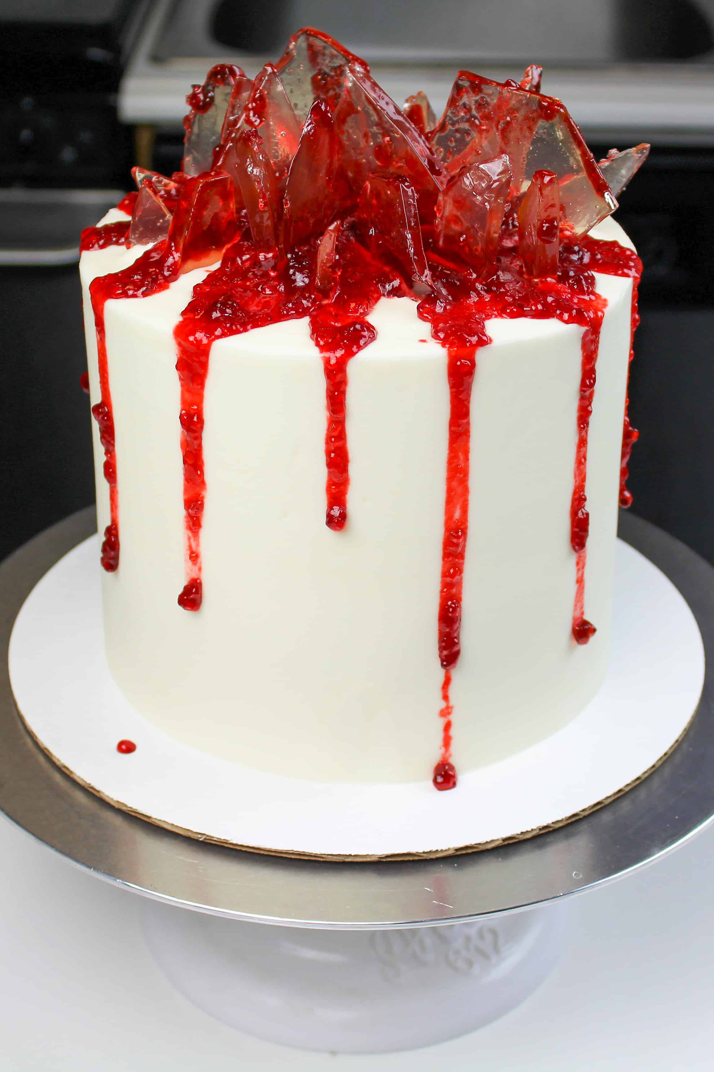 image of shattered glass cake made with sugar glass and strawberry jam