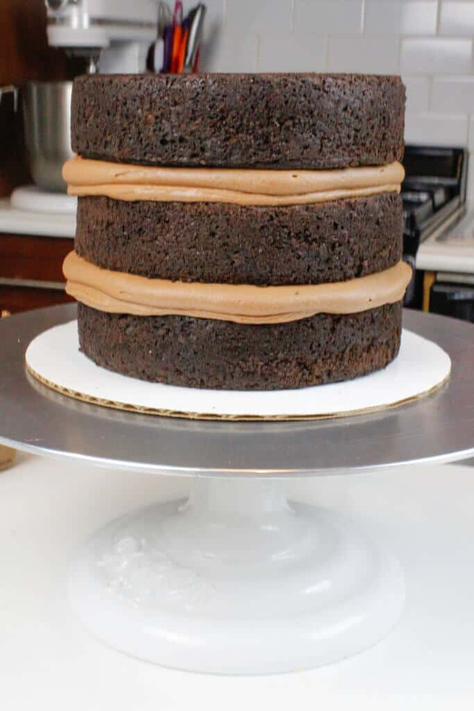 image of stacked, 6-inch chocolate layer cake