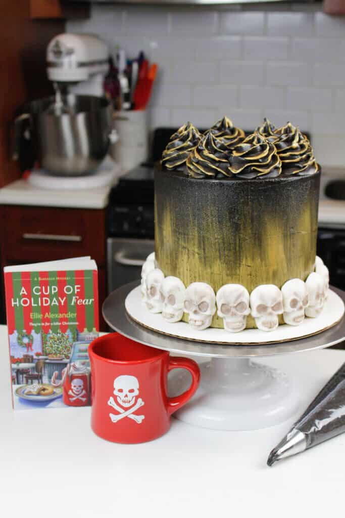 image of black velvet cake decorated with skulls