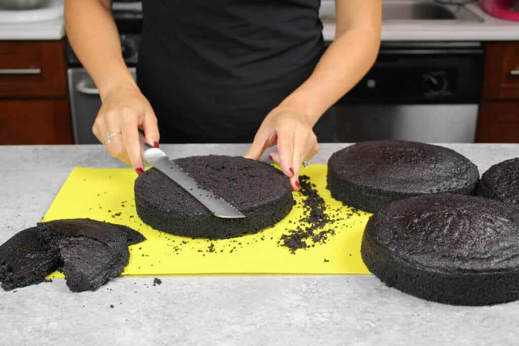 image of leveling black velvet cake layers