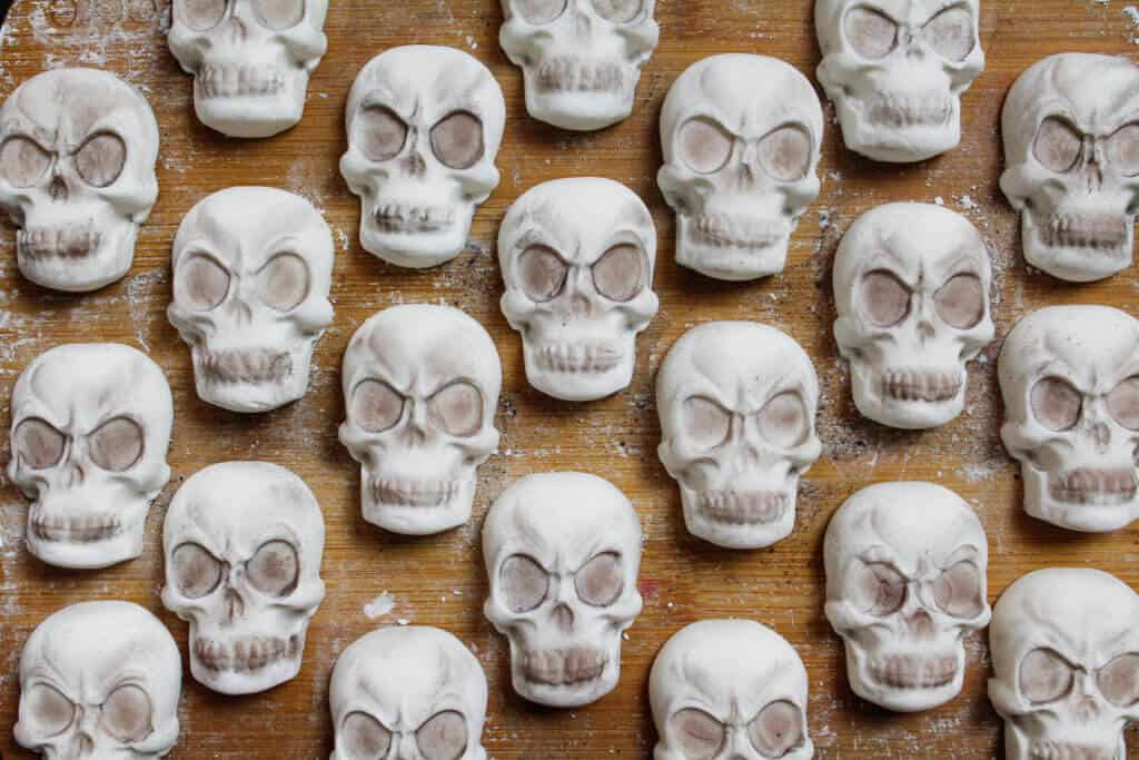 Image of fondant skulls for halloween cake decoration