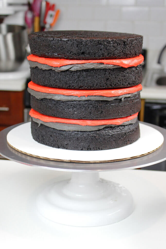 photo of stacked black velvet cake layers