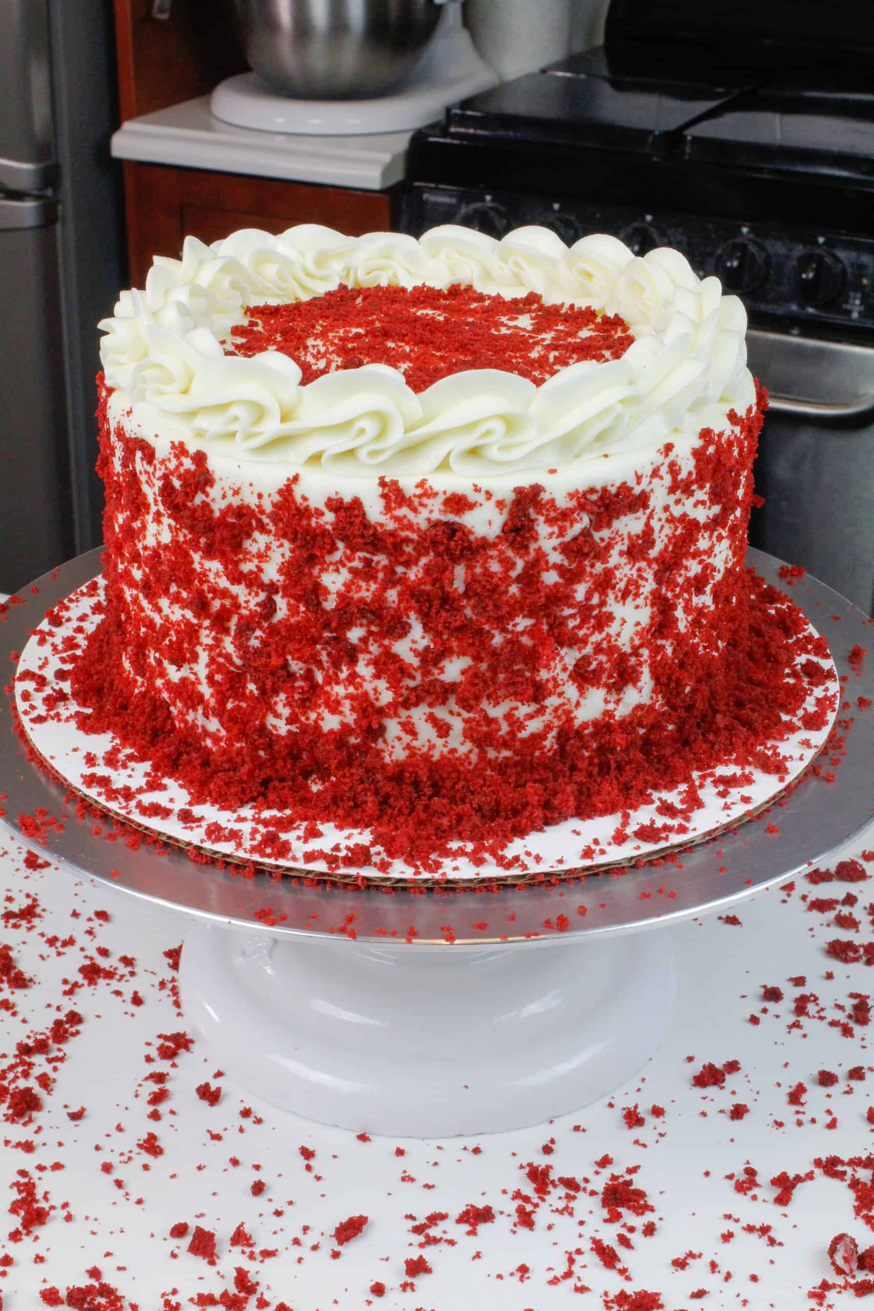 image of moist red velvet cake, decorated with reserved red velvet crumbs