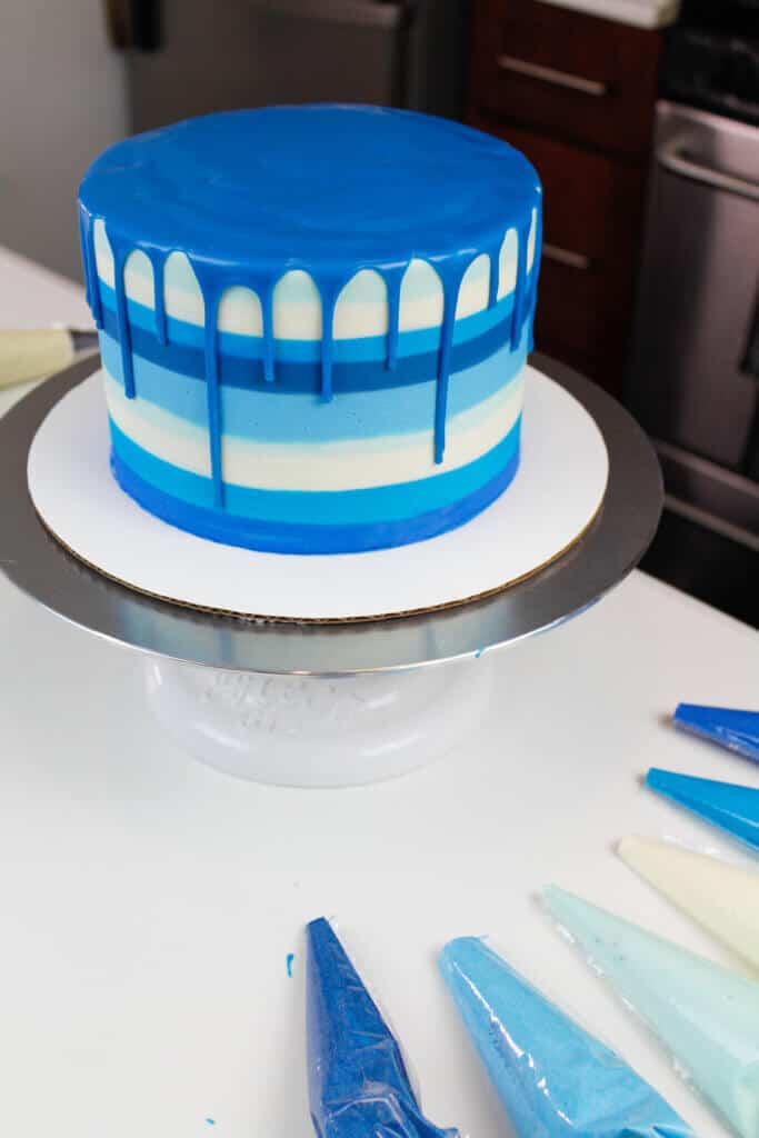 image of blue striped cake with a blue drip