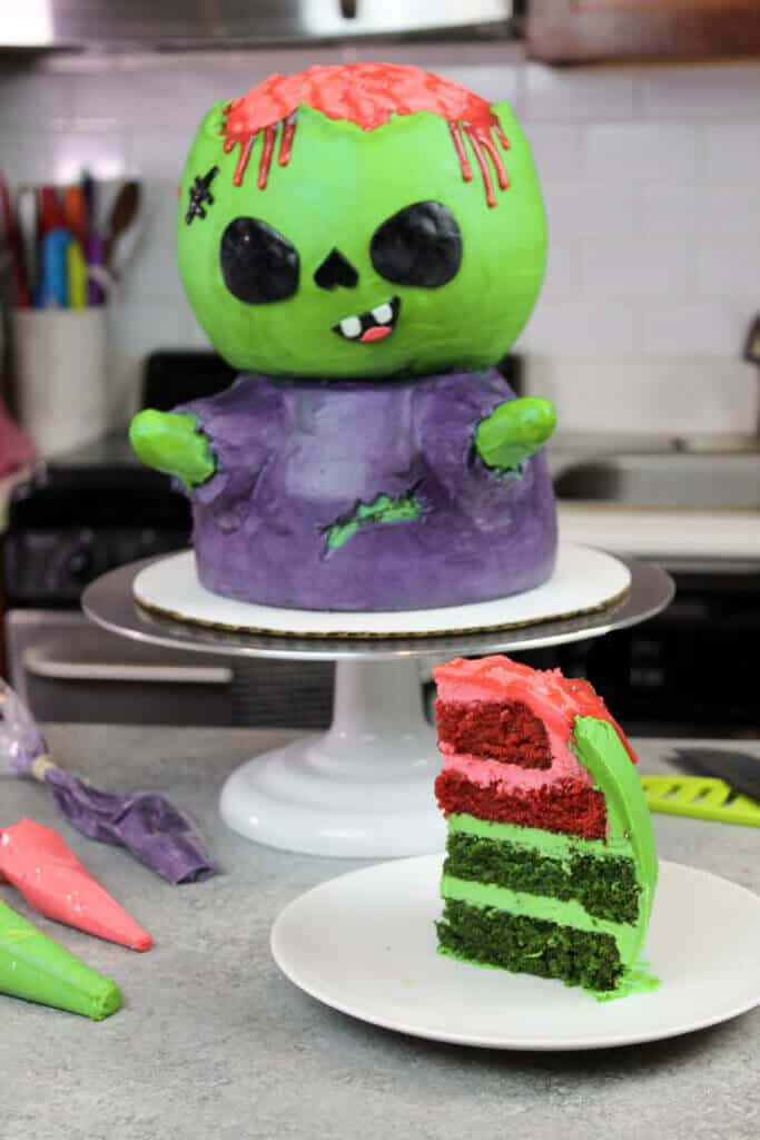 image of zombie cake with cake slice of green and red velvet cake layers