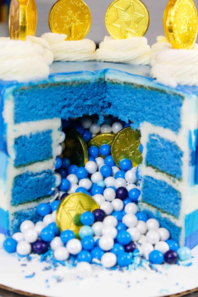 kah cake, filled with blue and white sprinkles and gelt