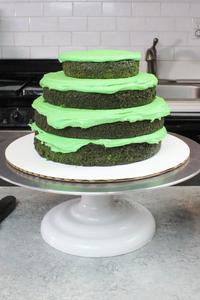 image of stacked green velvet cake layers