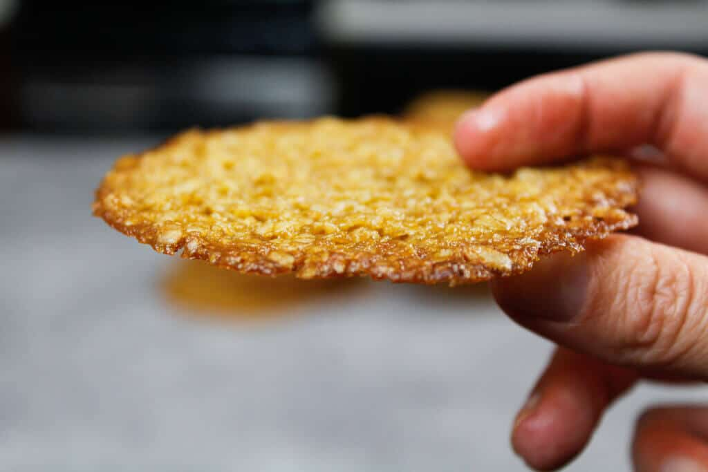 close up photo of oatmeal lace cookie's golden brown edge