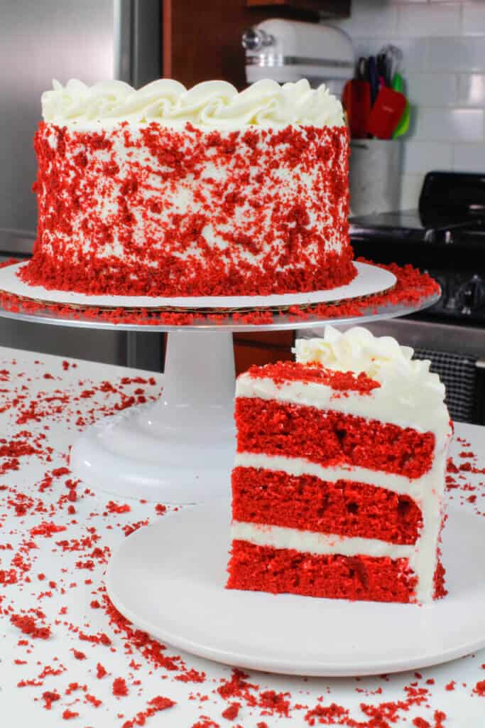 image of sliced red velvet cake, decorated with cake crumbs