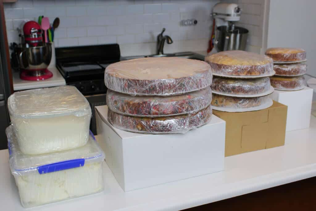 photo of wedding cake layers and frosting, prepped and wrapped for travel