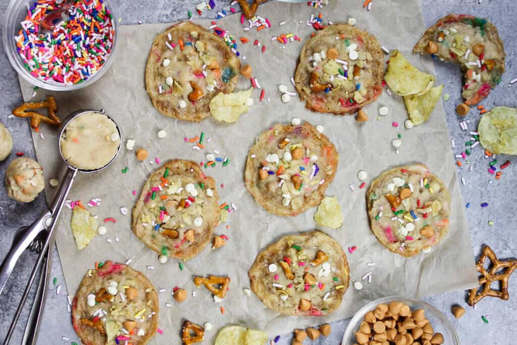 image of milk bar-inspired compost cookies from overhead, with ingredient scattered around them