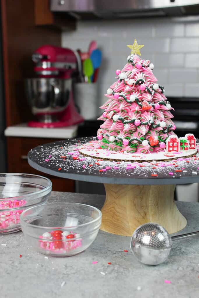 image of pink christmas tree cake dusted with powdered sugar snow