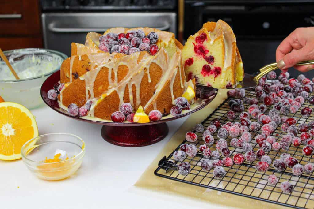 image of the best orange bundt cake with sugared cranberries