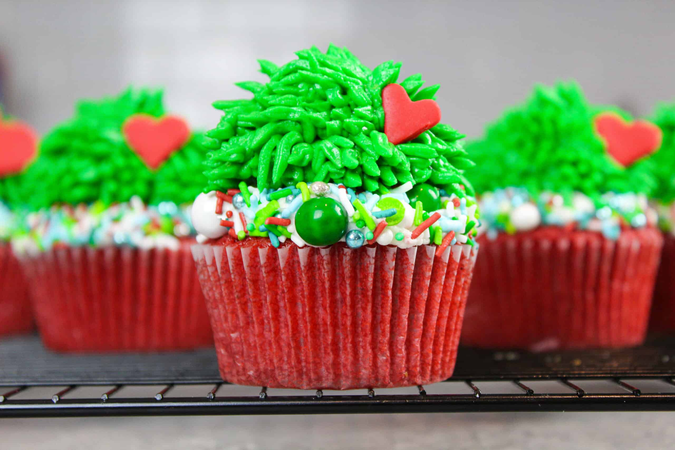image of grinch cupcakes that are easy to make with green buttercream fur