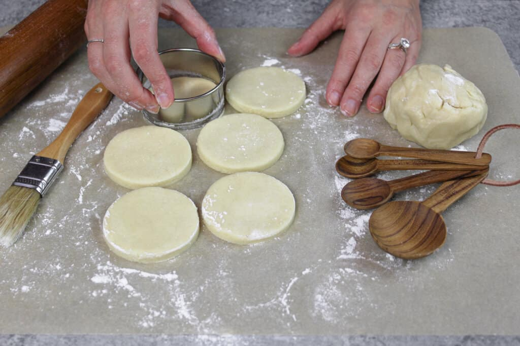 image of sugar cookies with cream cheese being cut out