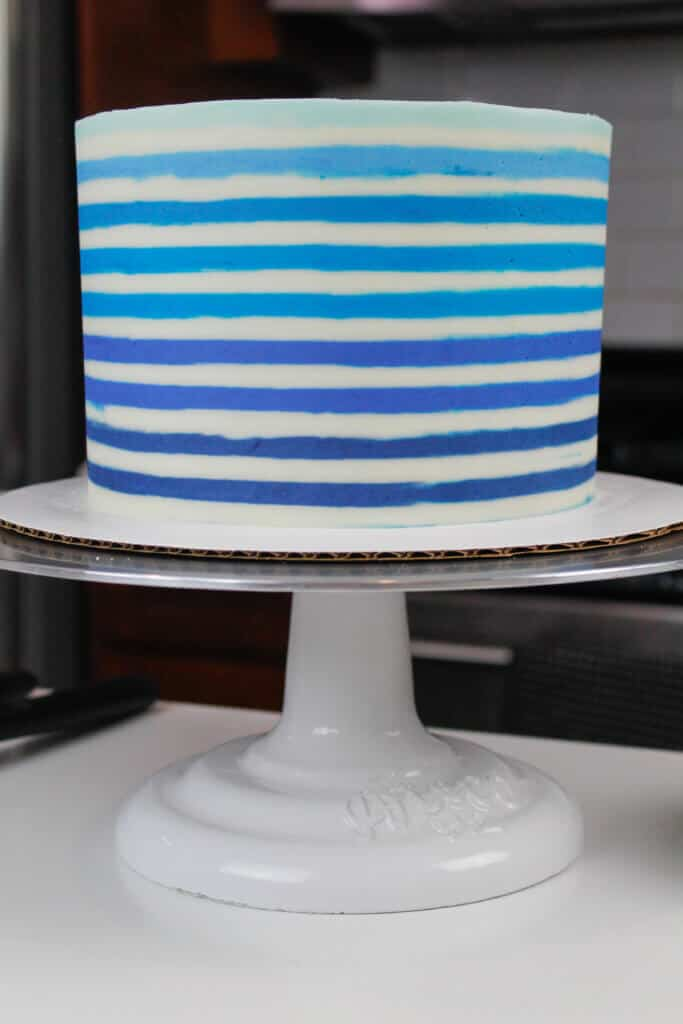 image of cake with blue horizontal buttercream stripes