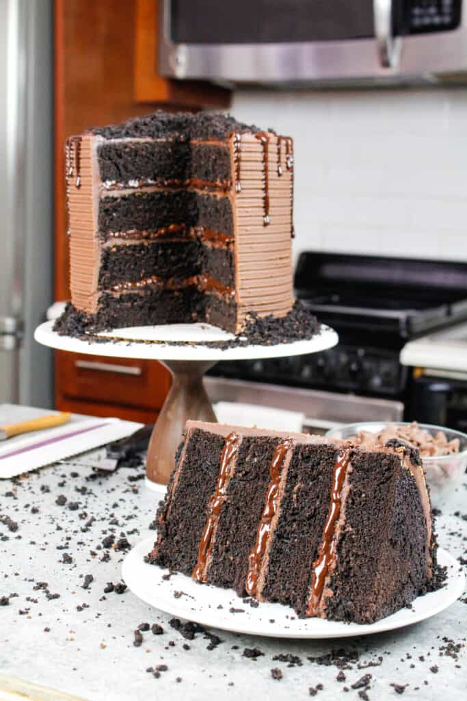 image of sliced open blackout cake with moist chocolate cake layers and chocolate filling