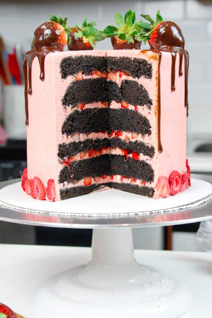 image of chocolate cake with strawberry buttercream and fresh strawberry filling