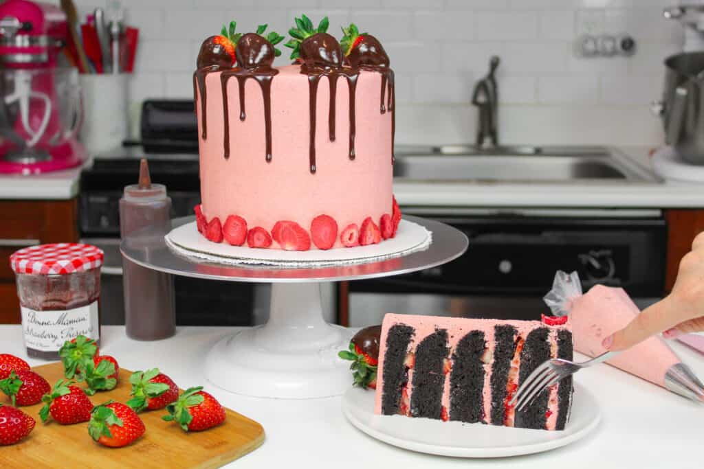 image of dark chocolate strawberry cake with slice cut