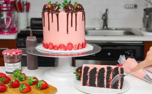 image of dark chocolate strawberry cake with slice cut
