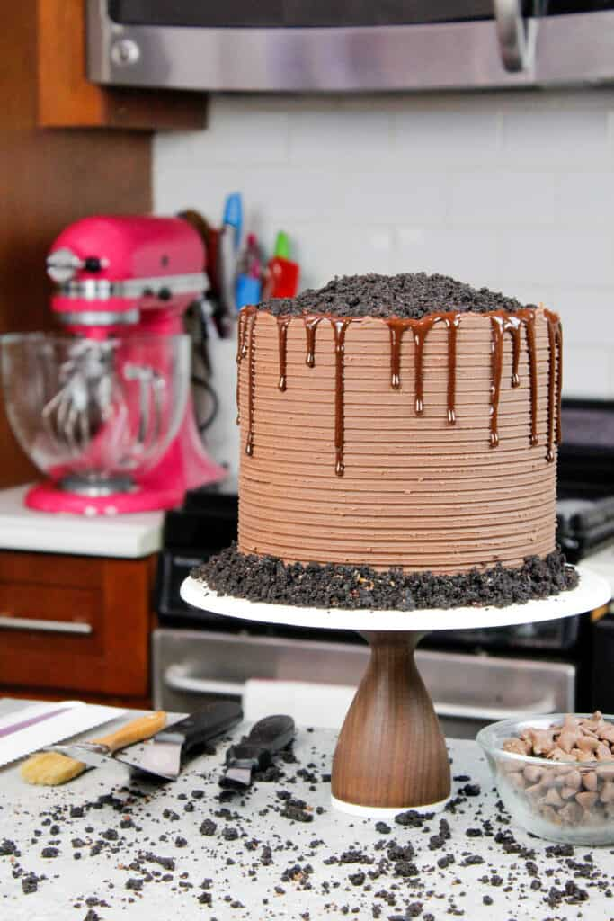 image of chocolate blackout cake covered in chocolate ganache and decorated with a chocolate drip and crumbed cake tops