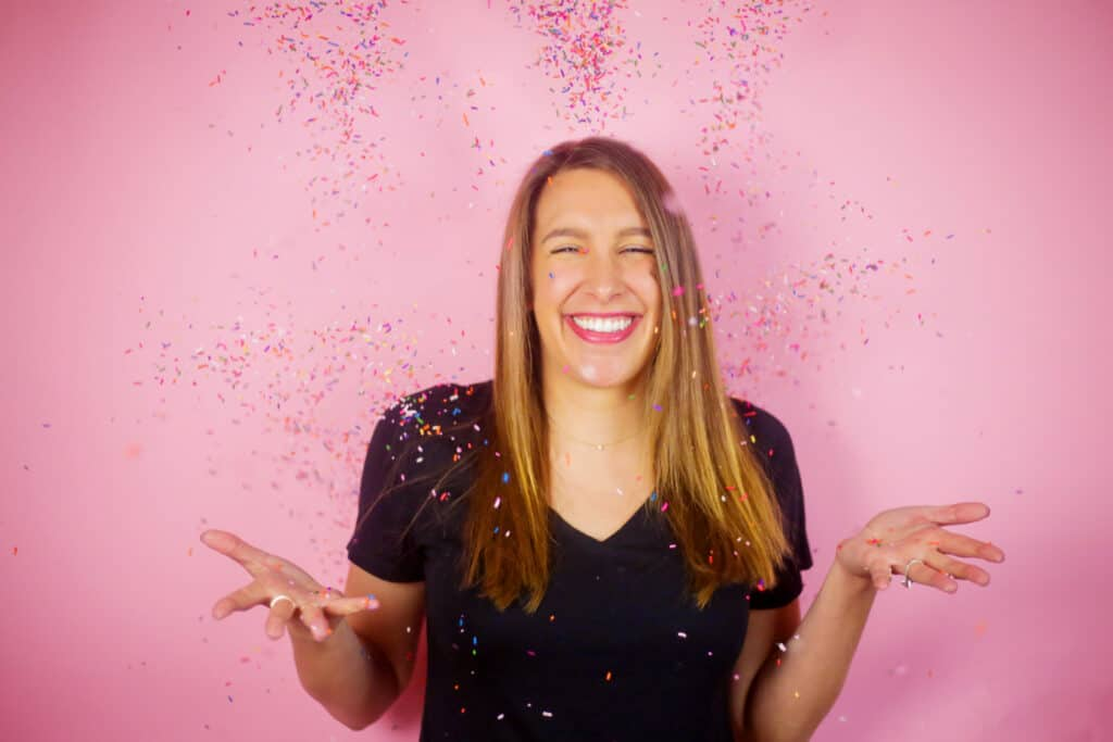 image of chelsey white of chelsweets, tossing sprinkles in the air