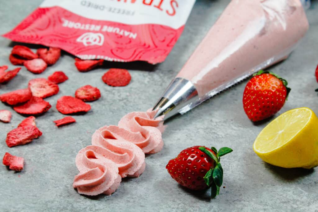 image of strawberry icing piped with a frosting tip
