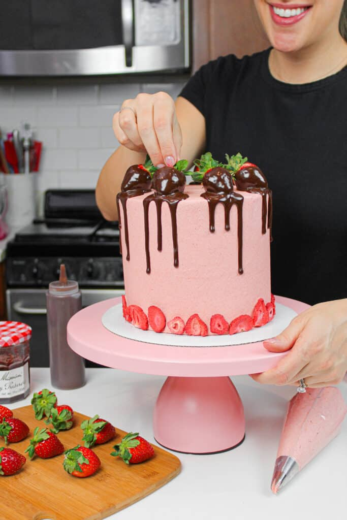 image of chocolate dipped strawberry cake with chocolate ganache and strawberry buttercream