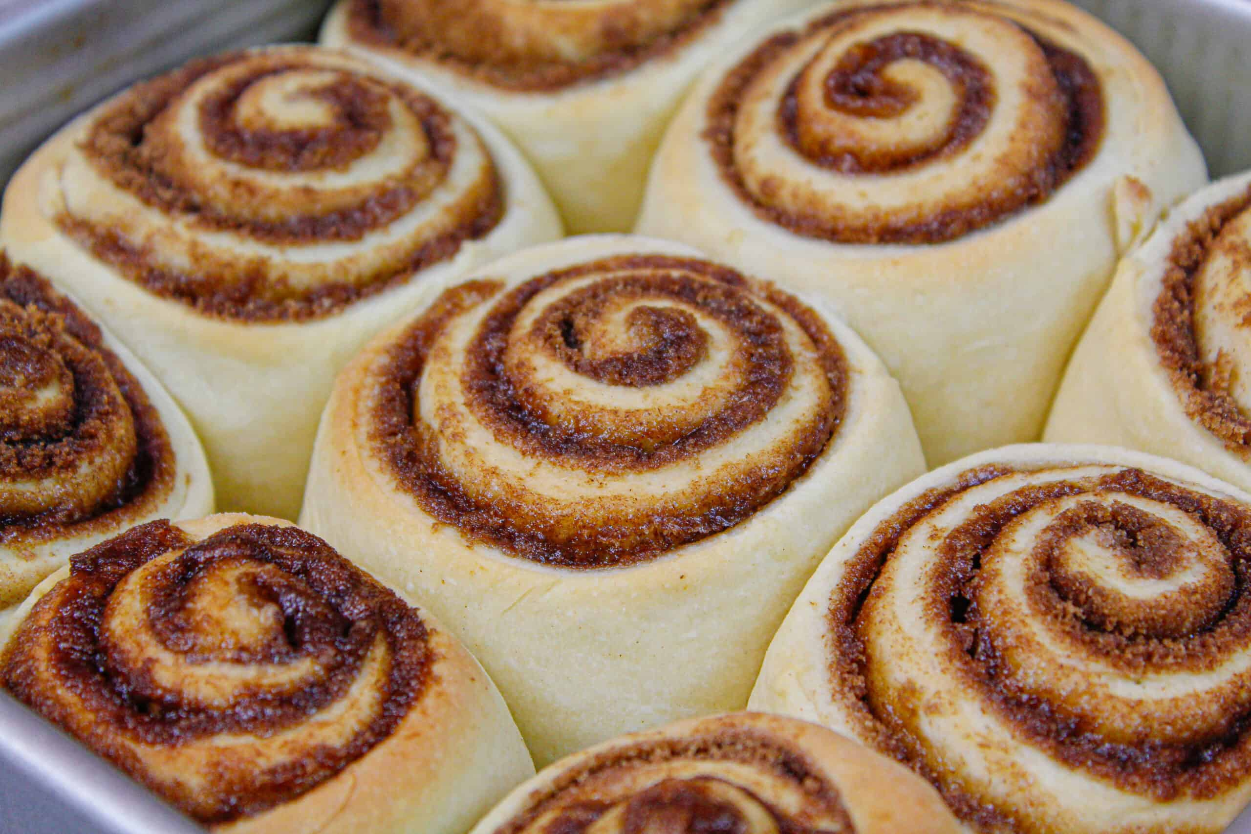 image of baked quick yeast cinnamon rolls, right out of the oven and baked golden brown with gooey centers