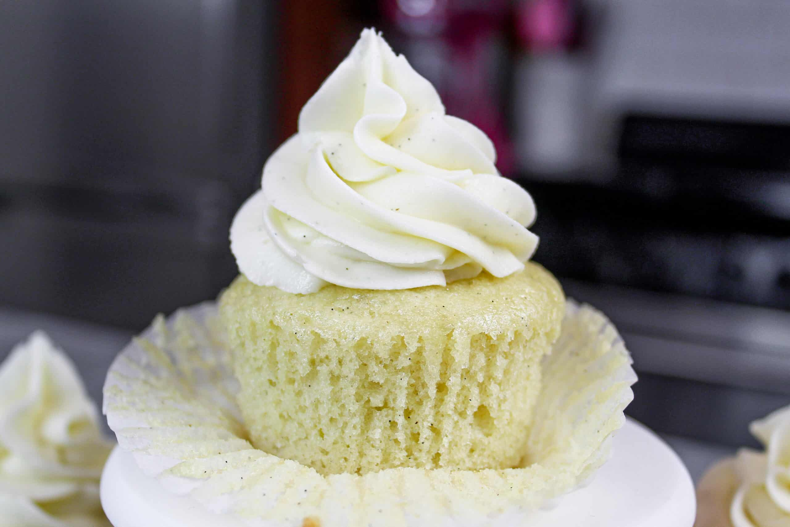 image of a gluten free cupcake, unwrapped to show how fluffy and moist it is