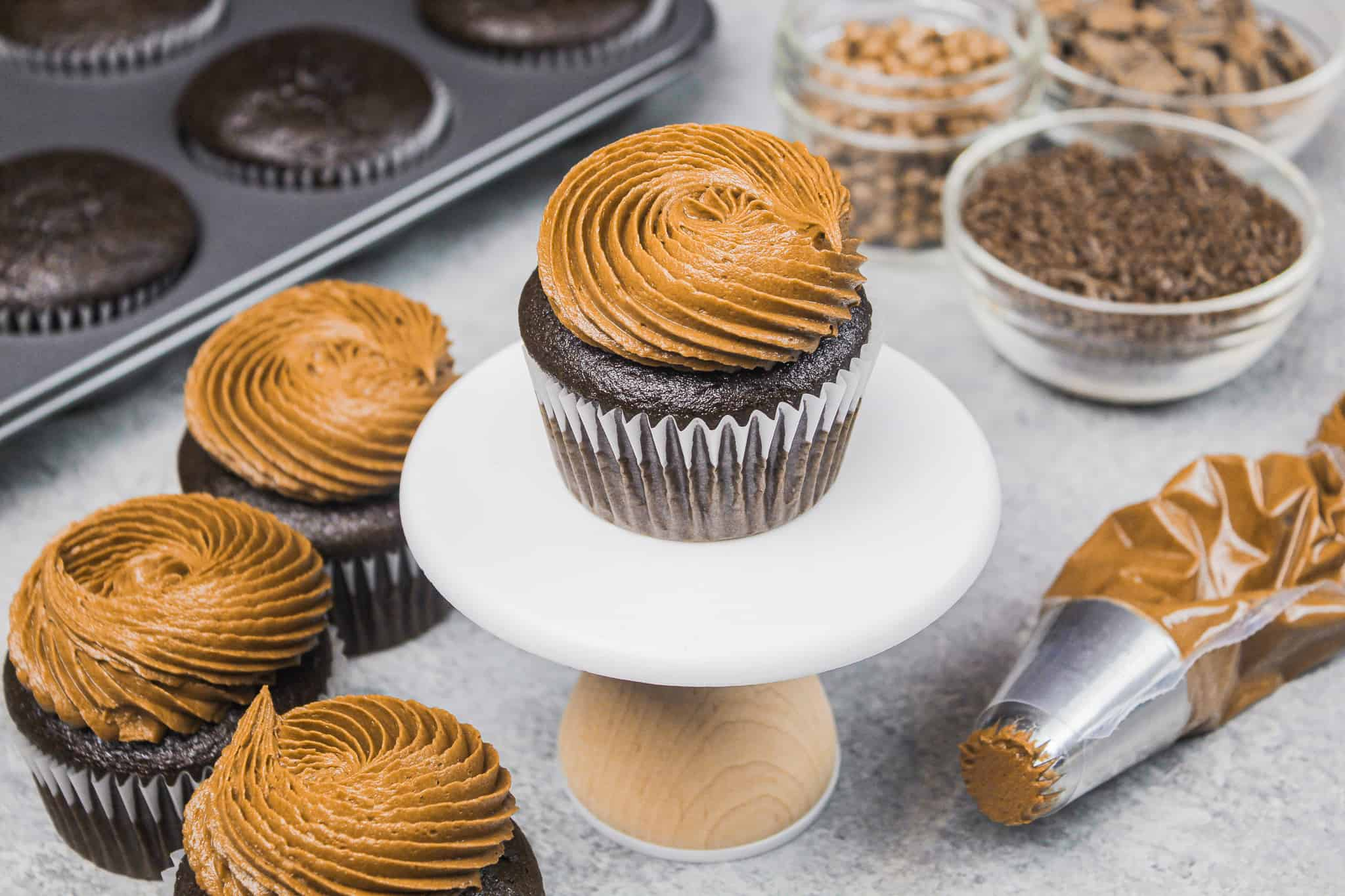 image of gluten free chocolate cupcakes frosted with a swirl of dark chocolate frosting