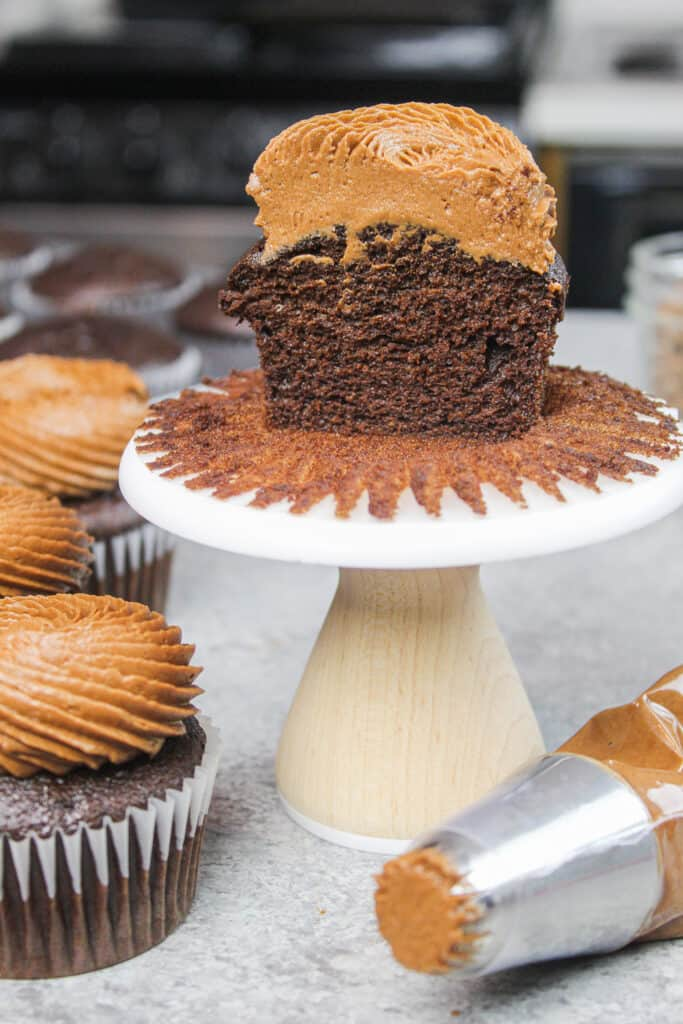 image of gluten free chocolate cupcake cut in half to show great structure and delicate crumb