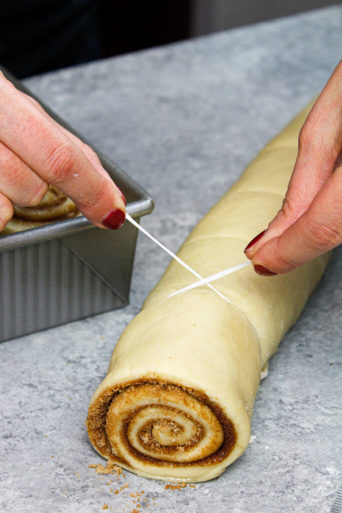 image of cutting a cinnamon roll with dental floss