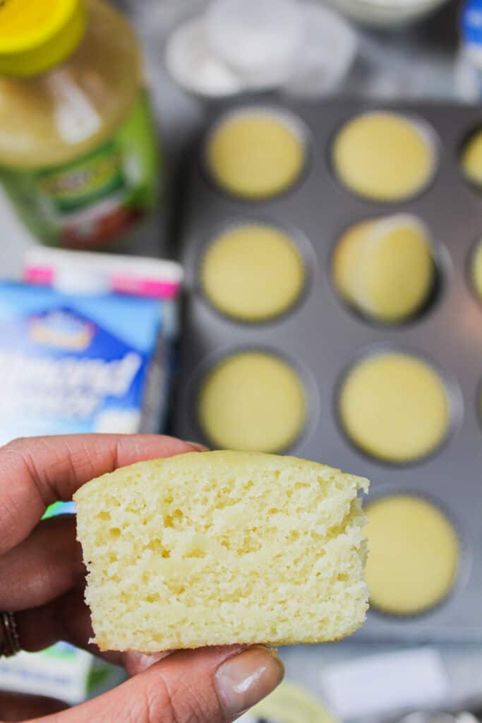 image of dairy and egg free cupcake, cut in half to show how tender and moist the cupcake is