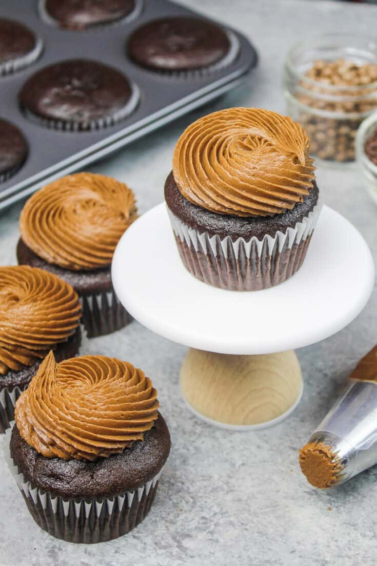 image of gluten free chocolate cupcakes frosted with a dark chocolate buttercream frosting