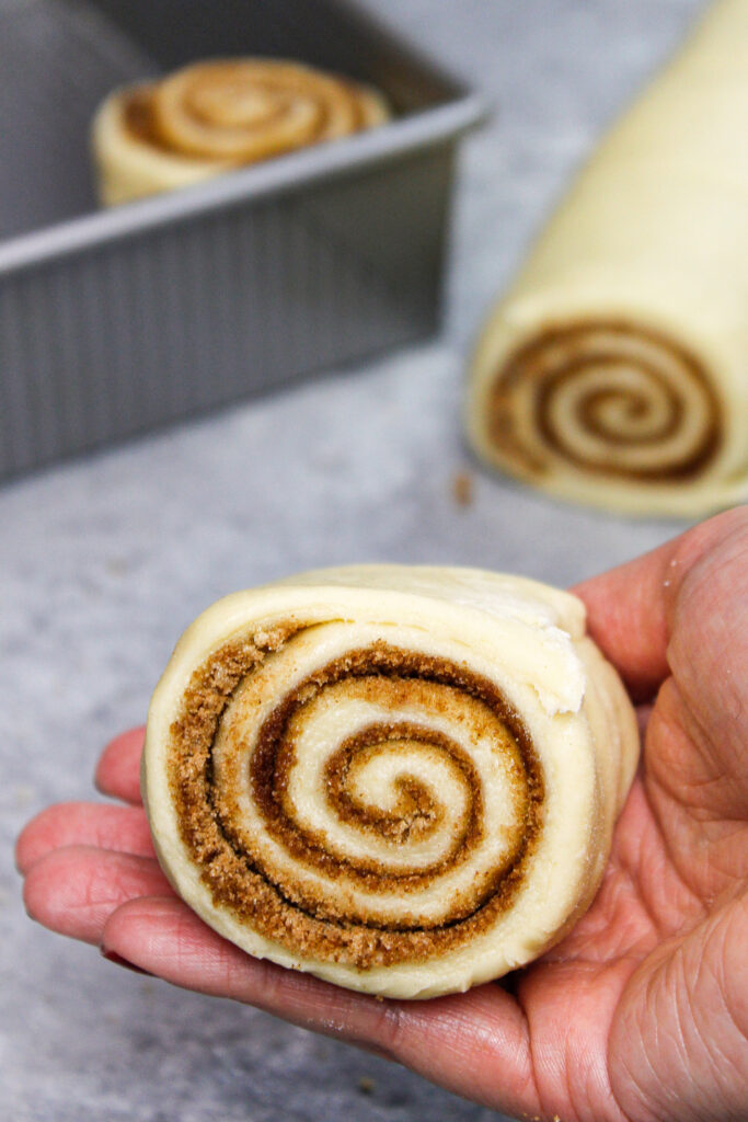 image of cinnamon roll perfectly cut using dental floss instead of a knife