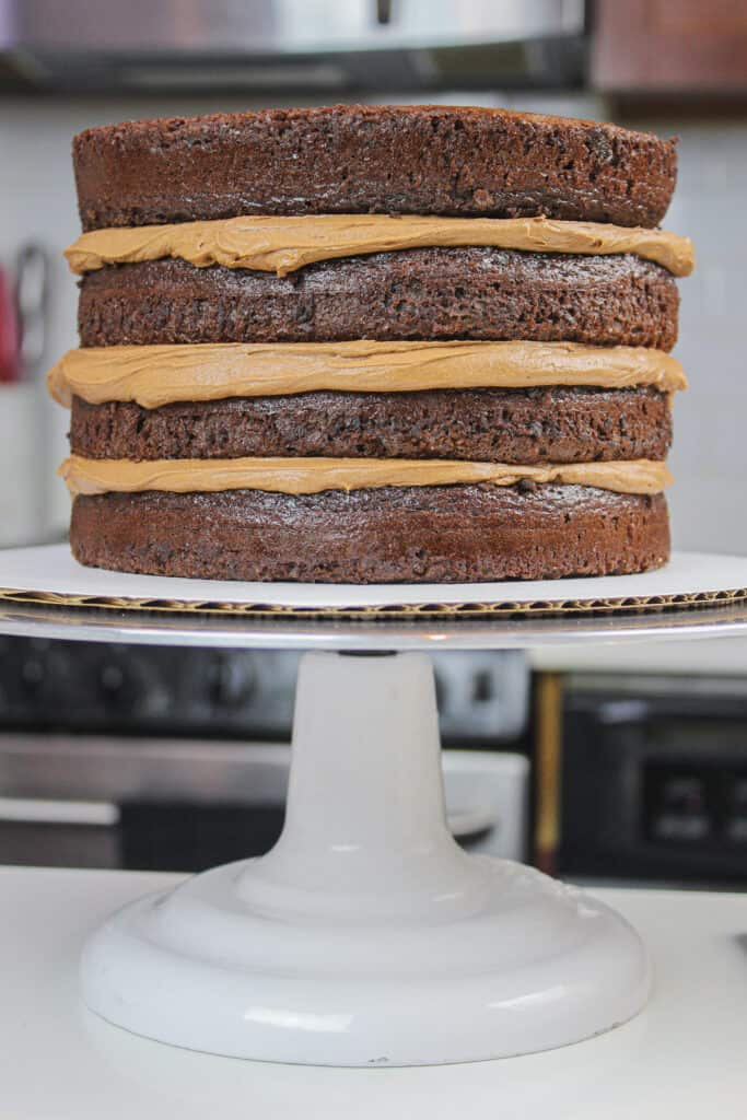 image of gluten free chocolate cake layers stacked with dark chocolate buttercream