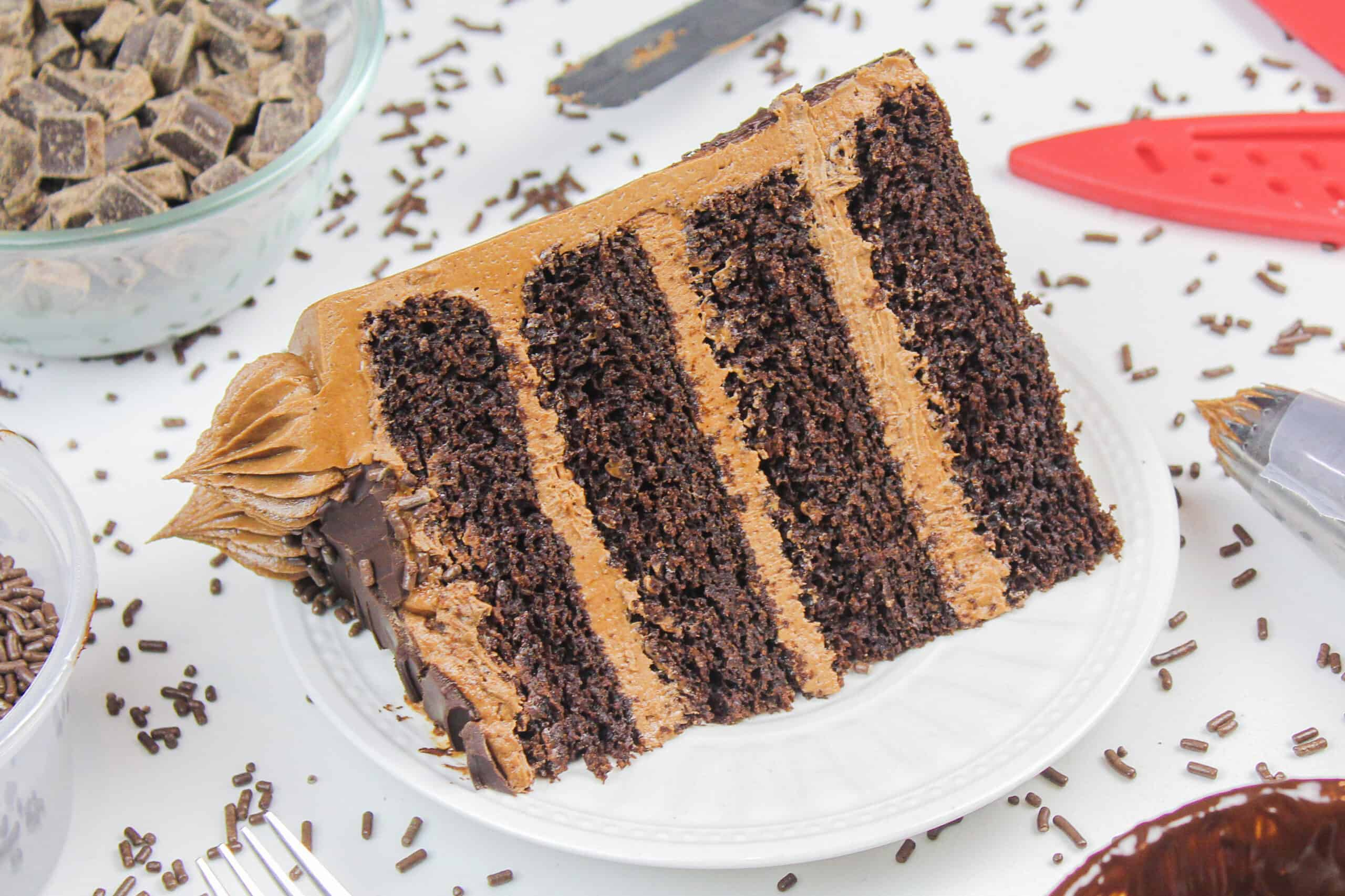 image of a slice of a moist and delicious gluten free chocolate cake with chocolate buttercream