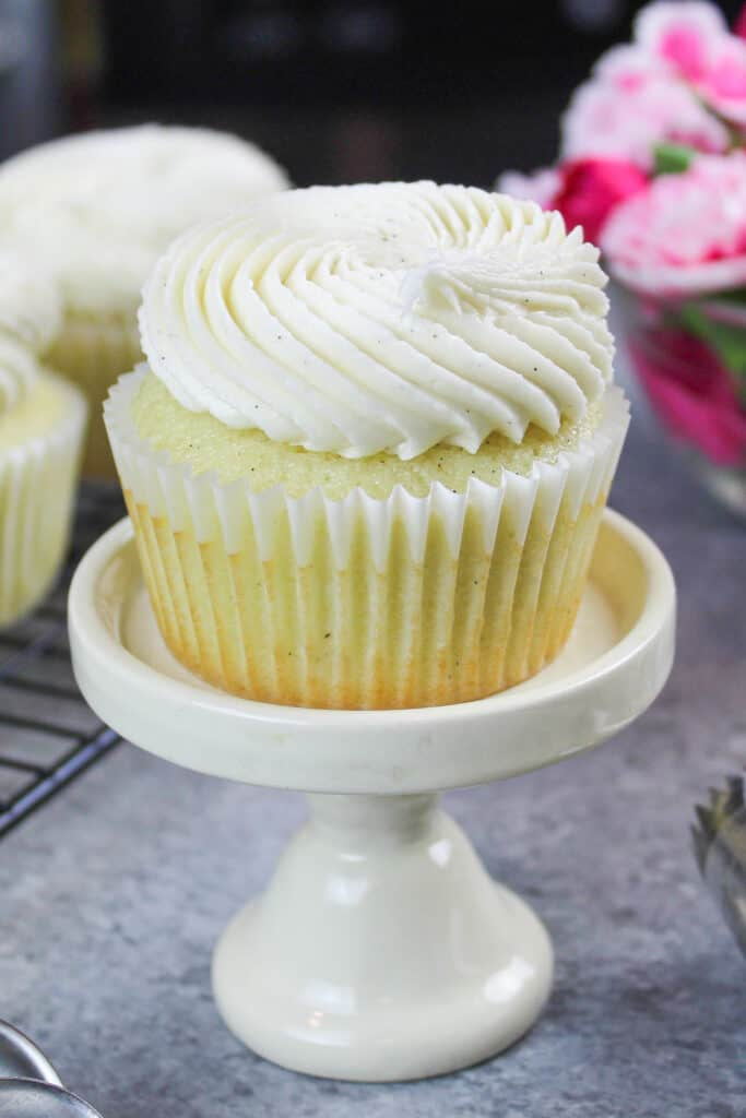 image of egg free cupcakes frosting with egg free buttercream frosting speckled with vanilla bean paste