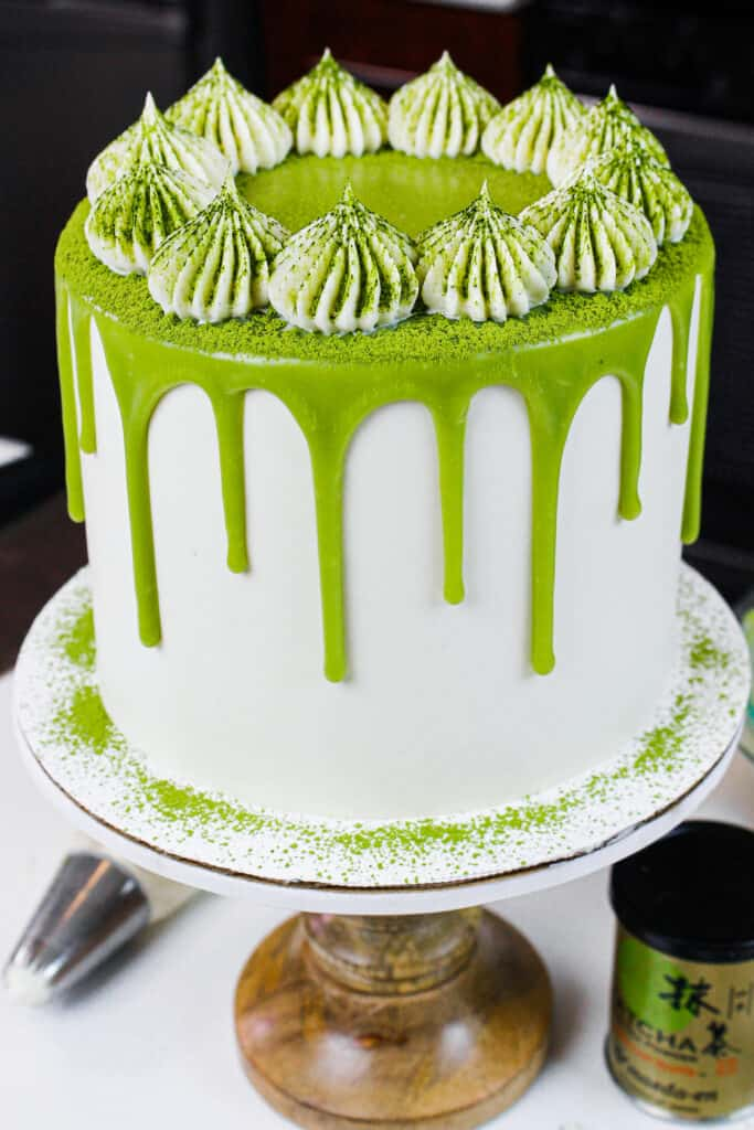 image of matcha cake on a wooden cake stand