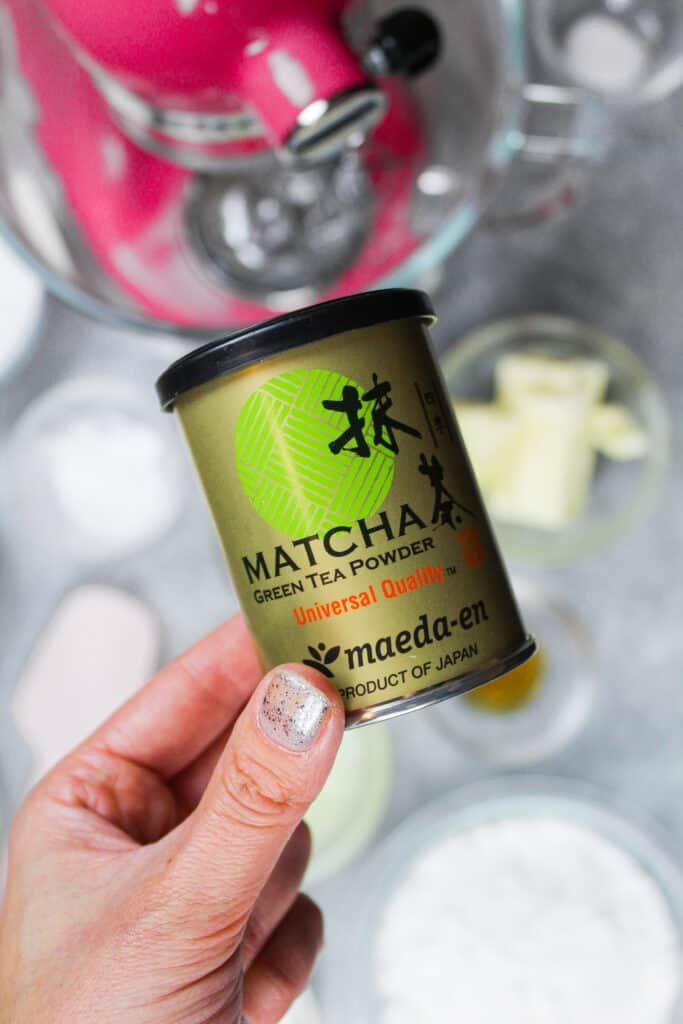 image of matcha powder in hand to make a  matcha cake