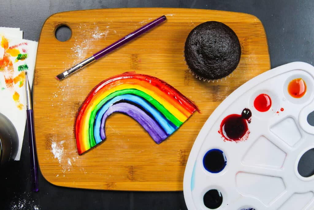 image of hand painted rainbow using fondant and gel food coloring
