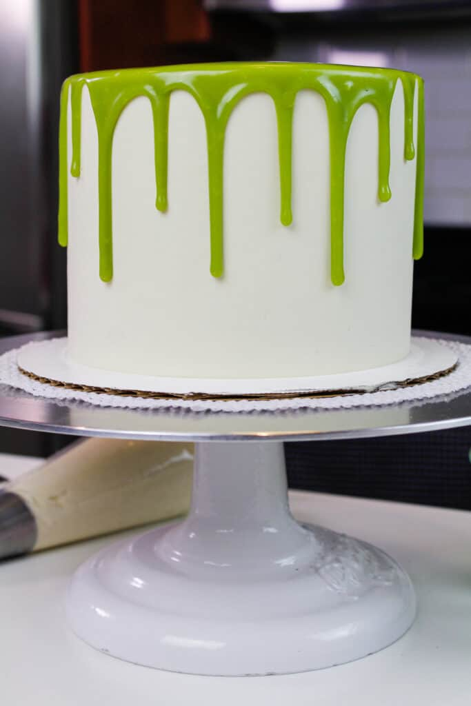 photo of a matcha cake decorated with green matcha drips