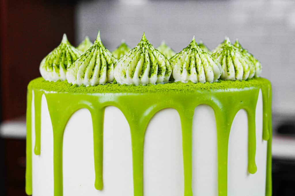 close up photo of a matcha cake, showing the frosting dollops piped with an ateco 869 frosting tip