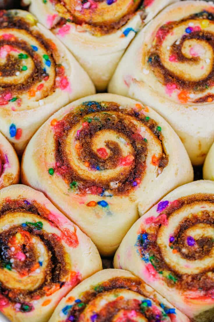 image of funfetti cinnamon rolls baked and cooling before adding the frosting