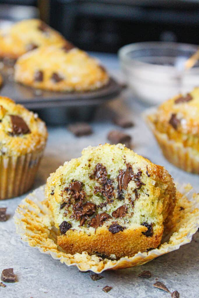 image of bitten into chocolate chip muffin, showing the melted chocolate